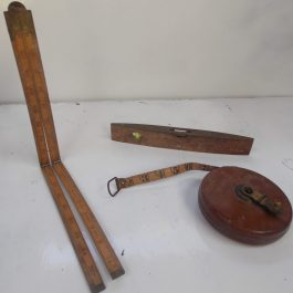 Antique tools extendable ruler, tape measure, wooden spirit level