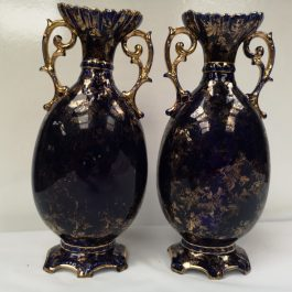 A pair of Cobalt blue antique vases decorated with scenes based on the work of Angelica Kaufmann